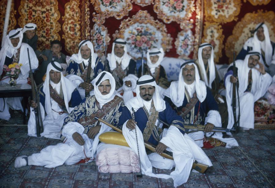 Armed Bedouin Beni Sakhr chiefs await their king's visit in Jordan, December 1964. PHOTOGRAPH BY LUIS MARDEN, NATIONAL GEOGRAPHIC